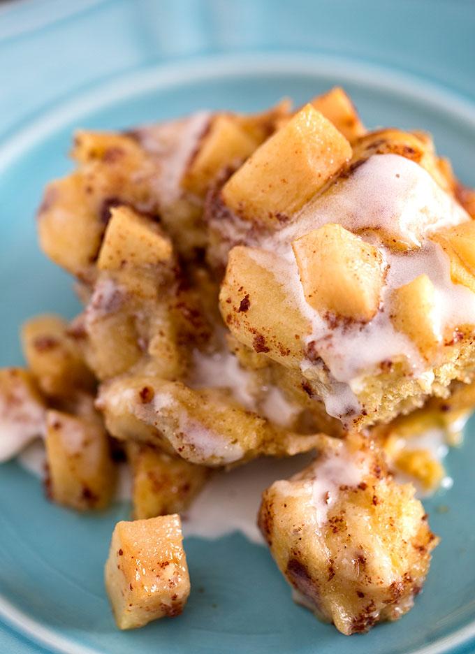 one serving of Crock Pot Apple Cinnamon Roll Casserole on a blue plate