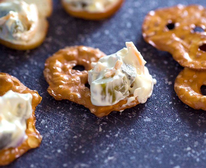 pretzel chip covered in dill pickle dip