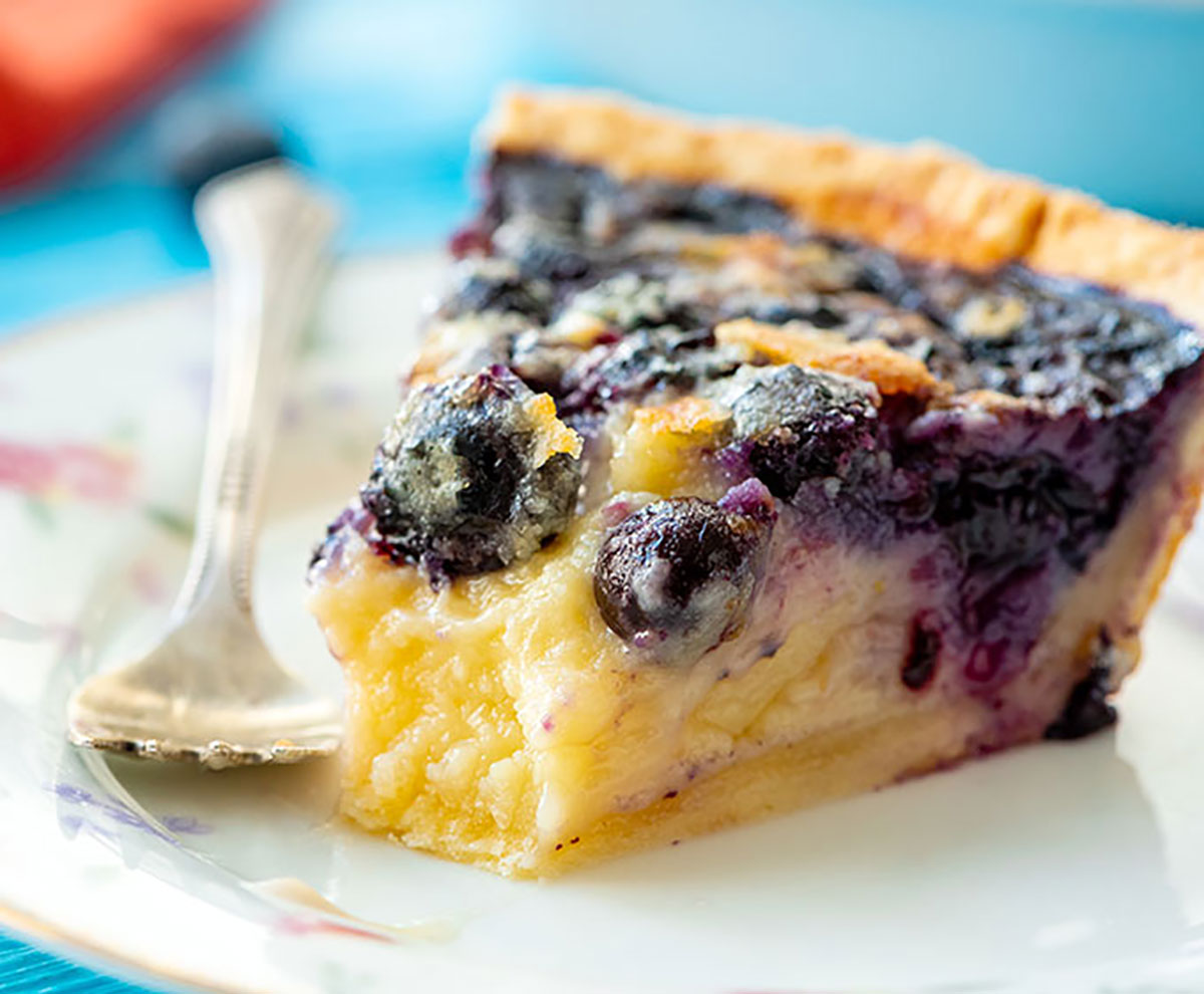 piece of buttermilk custard blueberry pie