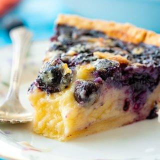 slice of blueberry buttermilk custard pie