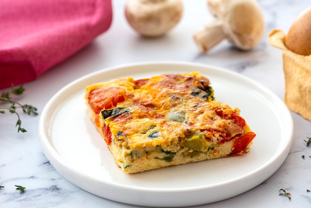 piece of loaded vegetable breakfast casserole on a plate