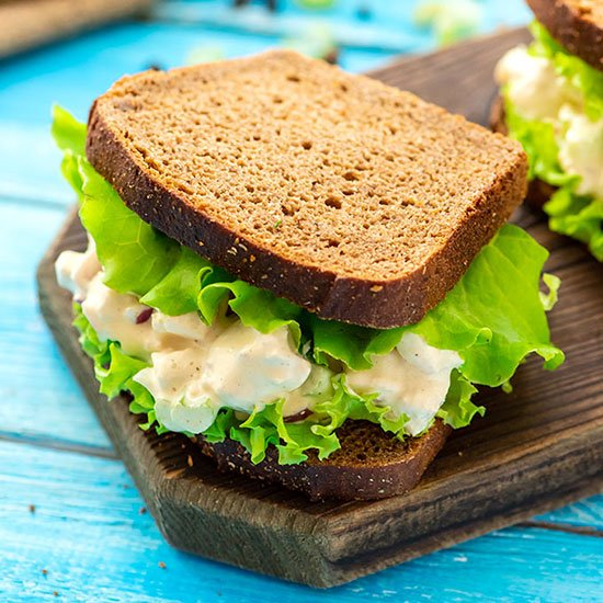 Chicken salad sandwich with lettuce on wheat bread