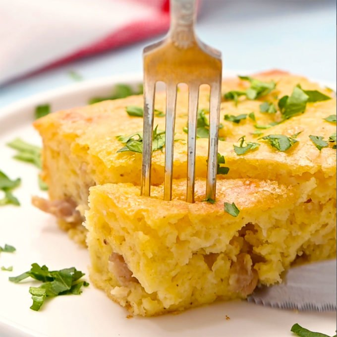 piece of sausage bisquick breakfast casserole on a plate with a fork going into it.