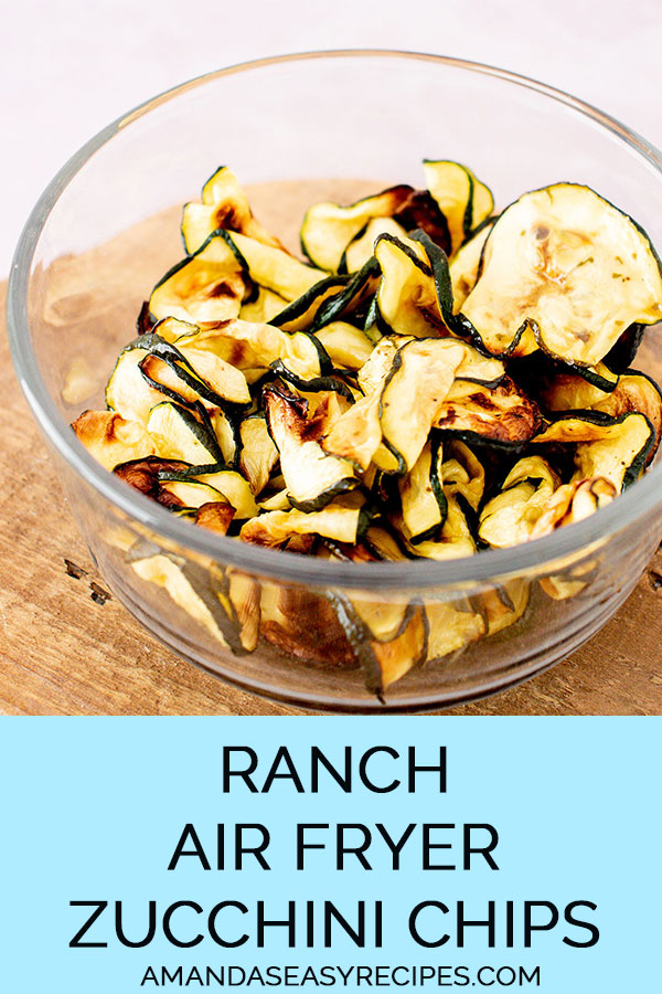 glass bowl full of air fried ranch zucchini chips with text overlay